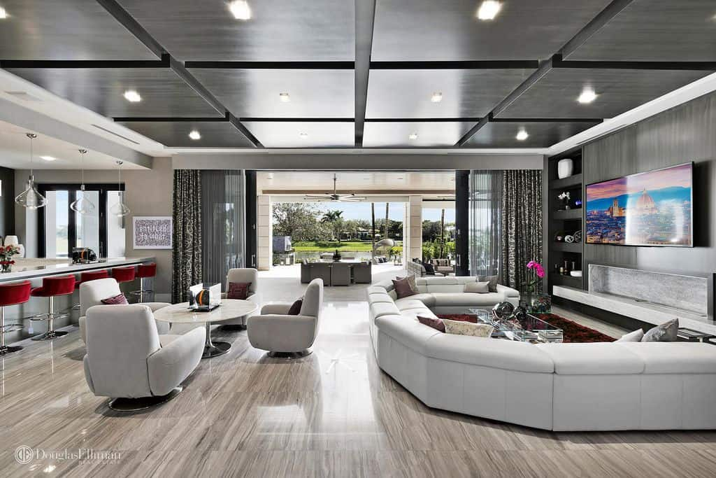 Massive family room that opens up to patio and swimming area.