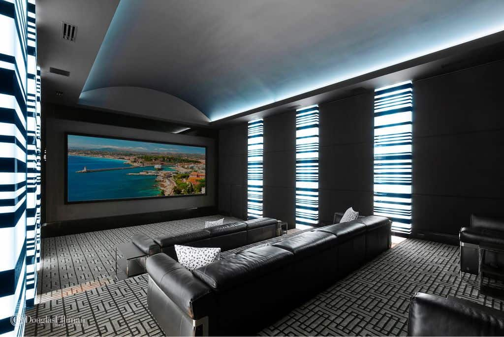Side view of incredible modern home theater with stadium seating.