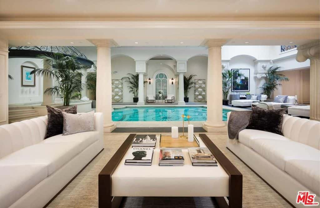 Incredible indoor swimming pool lounge area