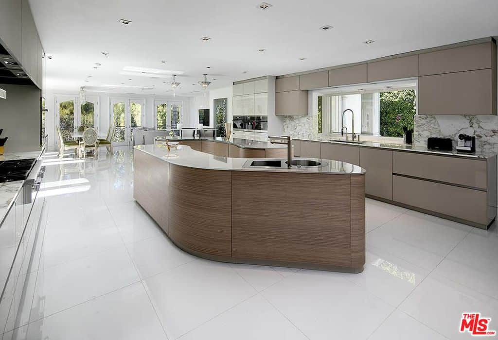 Huge modern kitchen with massive modern style island with a sink