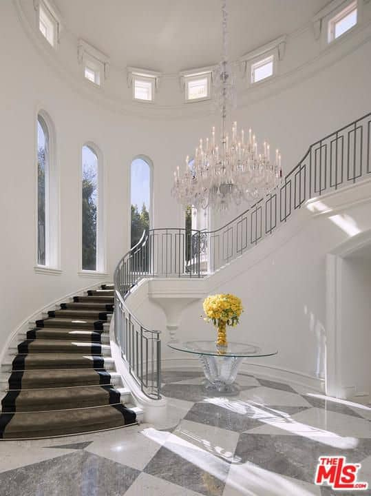 Incredible two-story foyer with winding staircase.