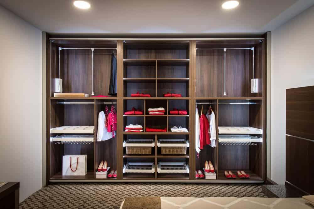 Closet organizer in a guest bedroom