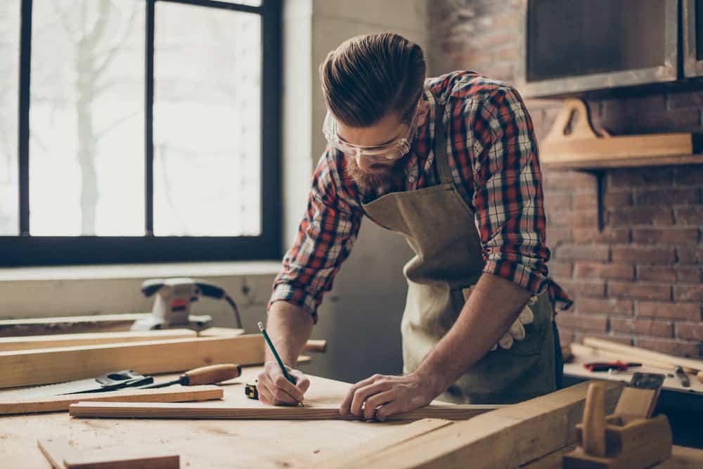 Man building custom furniture