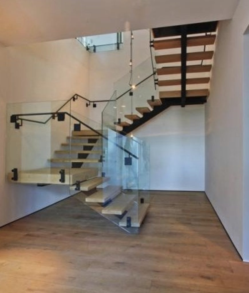 The mansion features a three quarter turn staircase leading to the house's second floor.
