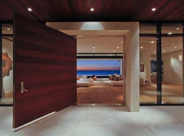 The doorway features a huge wooden door leading to outdoor space.