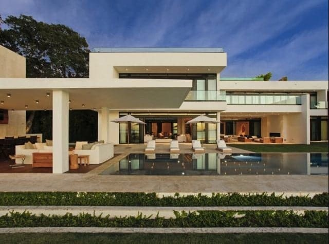 The outdoor of the house offers a patio, multiple seating lounge and a stunning infinity pool.