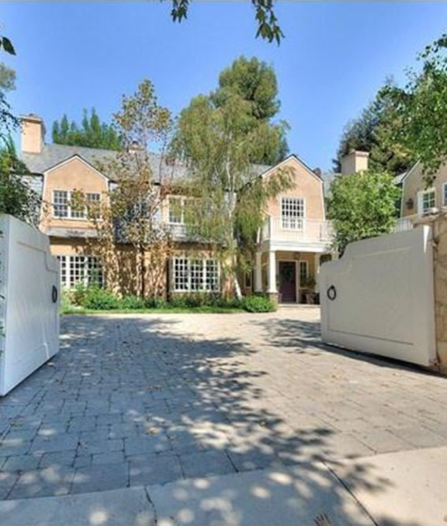 The mansion boasts a huge gated entryway, welcoming family and guests with elegance.