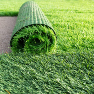Artificial grass carpet on a soccer field.