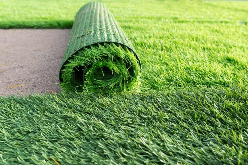 Artificial grass carpet on a soccer field.