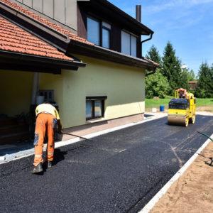 Construction of an asphalt driveway.