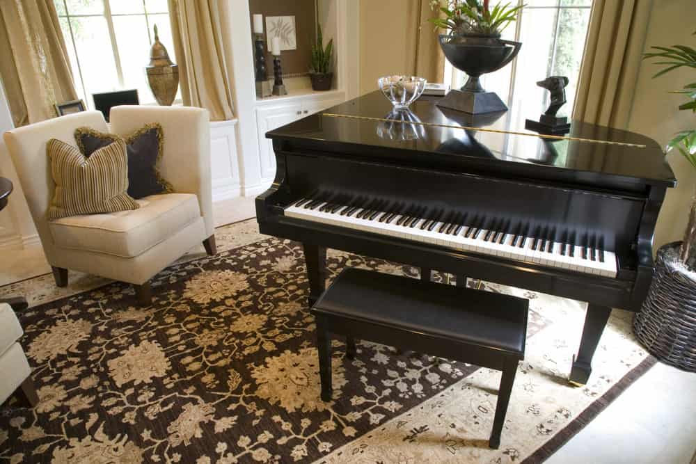 Baby grand piano in the living room.