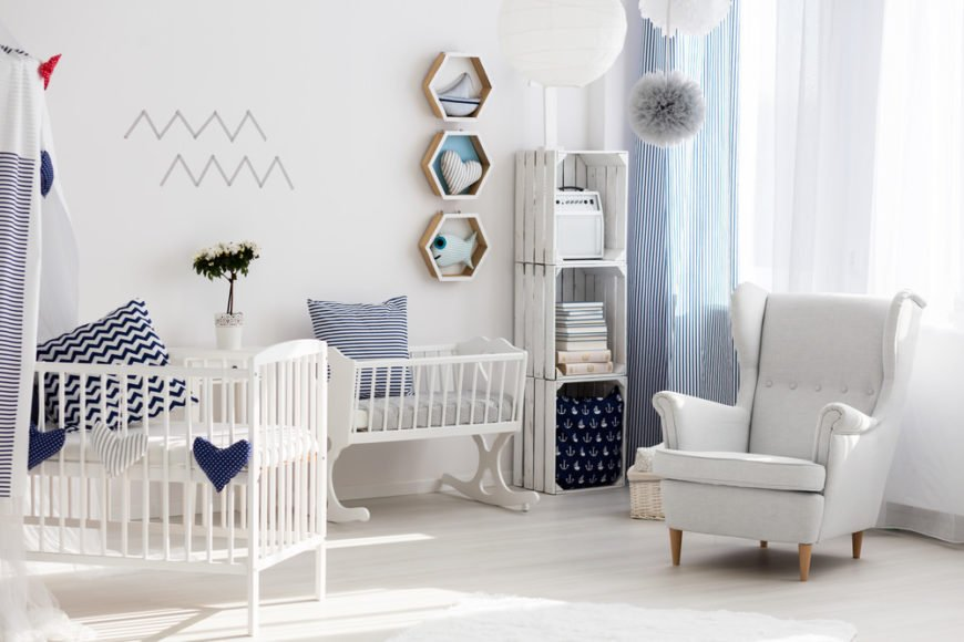 Baby nursery with crib and chair