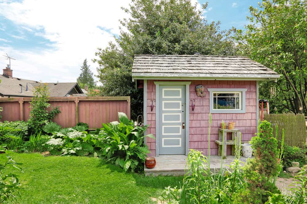 Backyard shed with decorative door