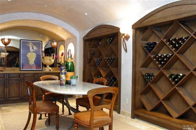 The Bar Includes A Large Wine Cellar Along With An Oval 4 Seat Table.  Recessed Lights On Cathedral Ceiling Brightens The Area.