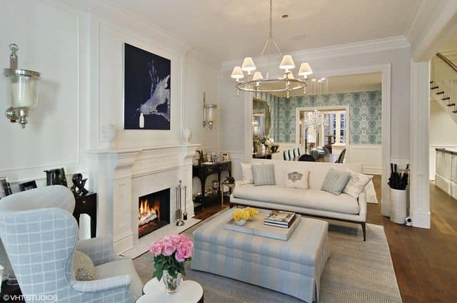 Another look of the loving room focusing on the beautiful sofa set that perfectly fits with the white walls and hardwood flooring.