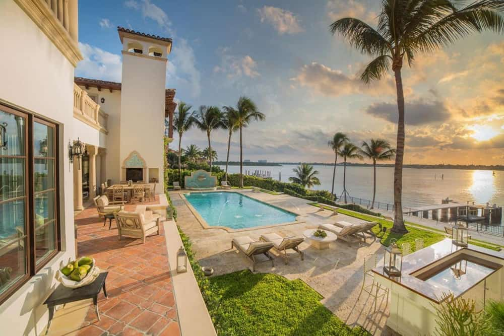 This luxurious backyard features a pool side patio area overlooking the beautiful surrounding.
