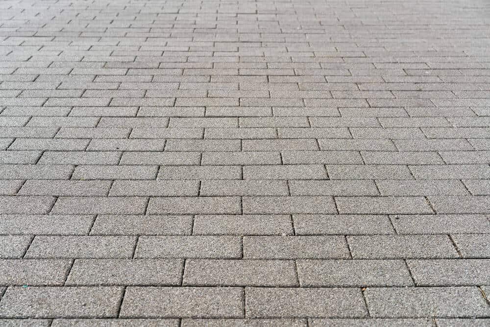 Driveway with gray bricks.