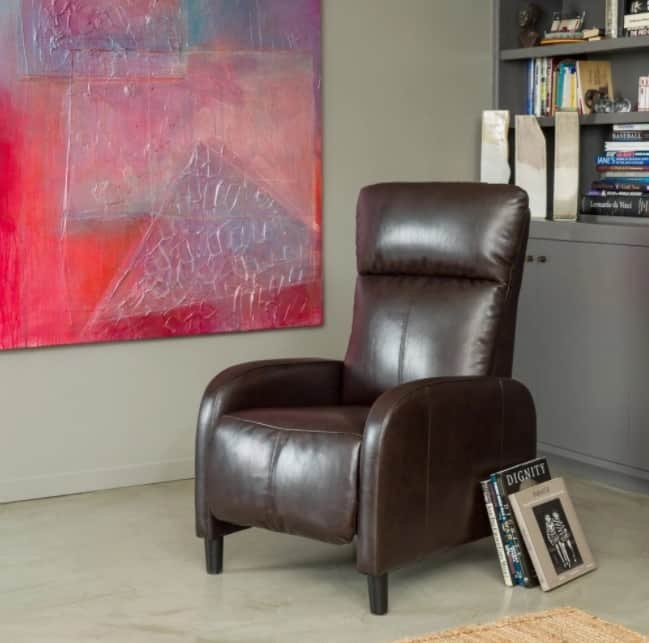 Decorative recliner made out of deep brown bonded leather and wooden legs.