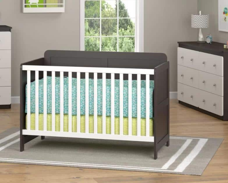 Brown, wooden crib with a smooth laminated finish.