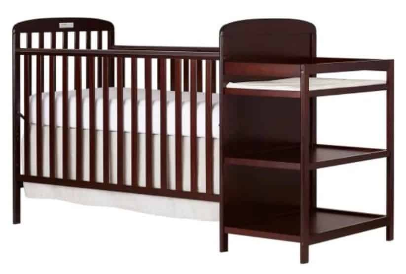 Wooden crib and changer combo in a dark brownish red shade.