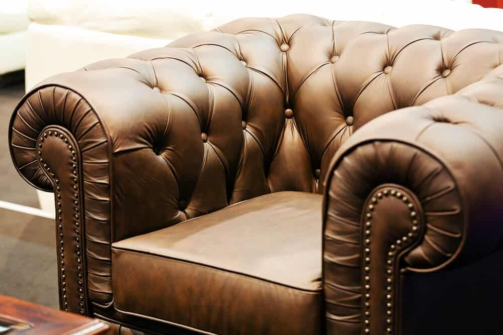 A club chair with a detailed and firm cushion.