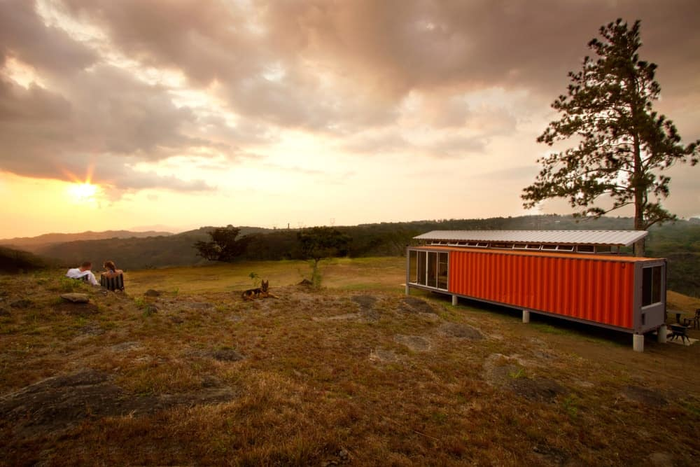 A dusk view of the Containers of Hope modern house. Photo credit: Andres Garcia Lachner