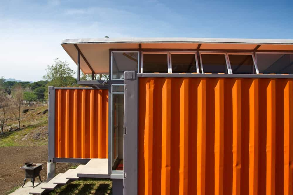 Containers of hope home side view with orange color and modern built. Photo credit: Andres Garcia Lachner