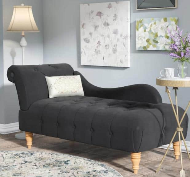 Dark charcoal chaise lounge with one arm.