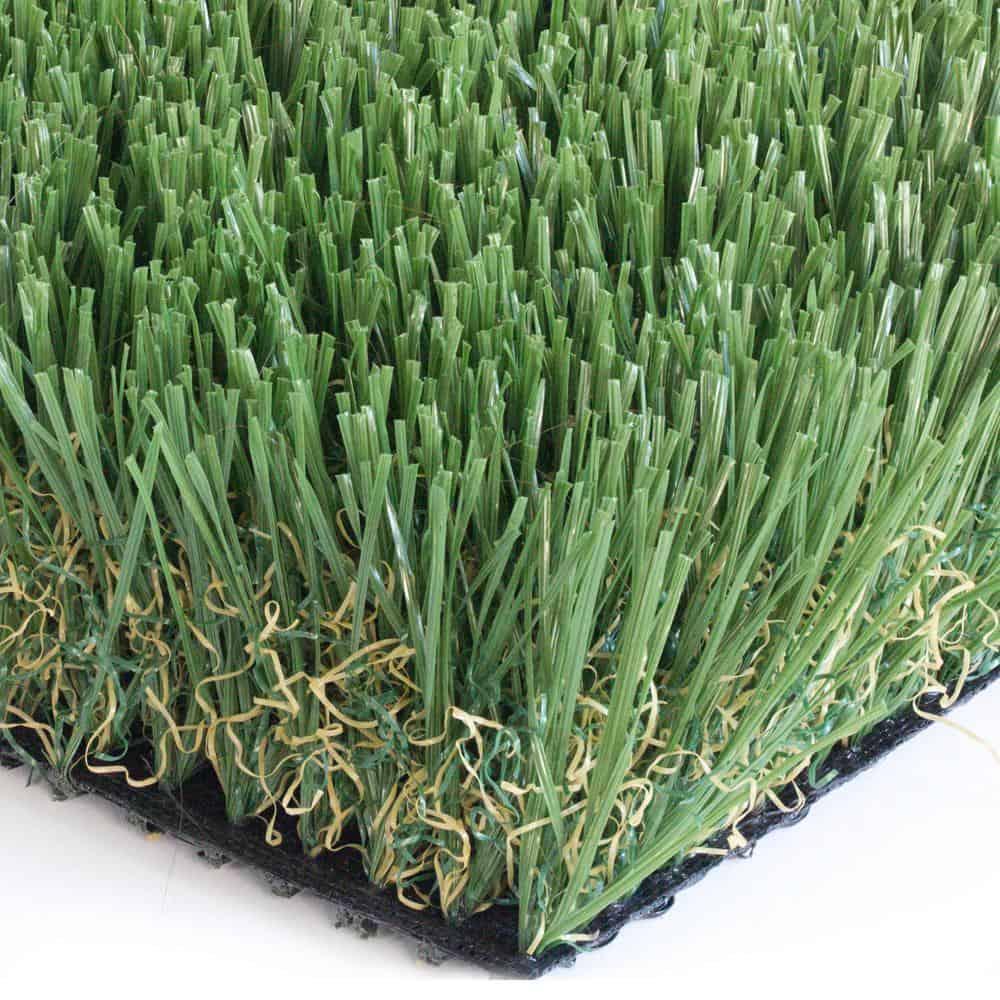 Dark-green artificial grass with soft blades.