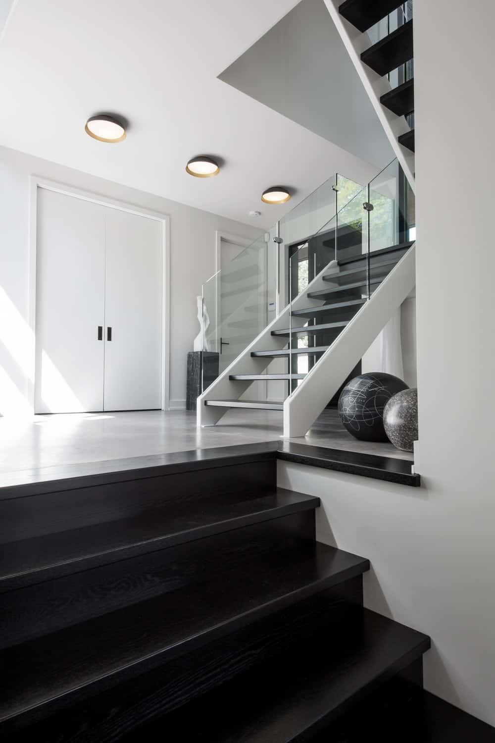 Modern style staircase with white walls surrounding the area. Photo credit: Steve Montpetit