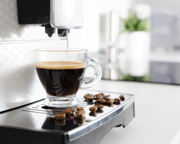 An espresso machine brewing coffee.