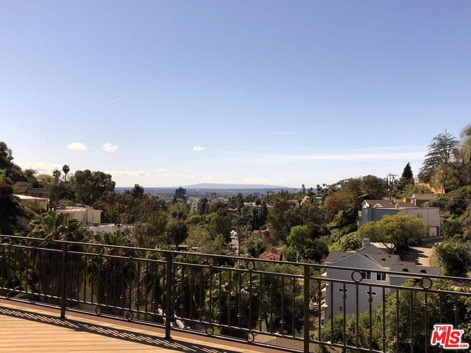 The house's terrace offers a stunning view of the Hollywood Hills.