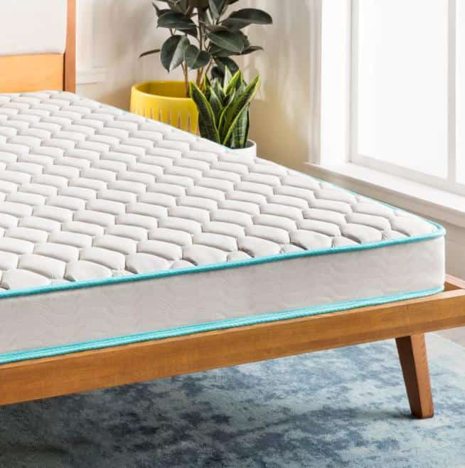 White, firm innerspring mattress with a light blue lining.