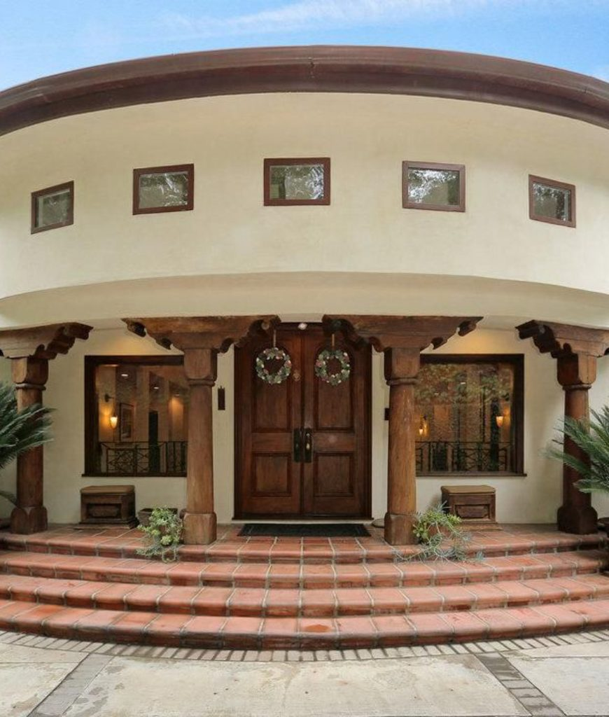Grand looking entrance with stairway greets family and friends.
