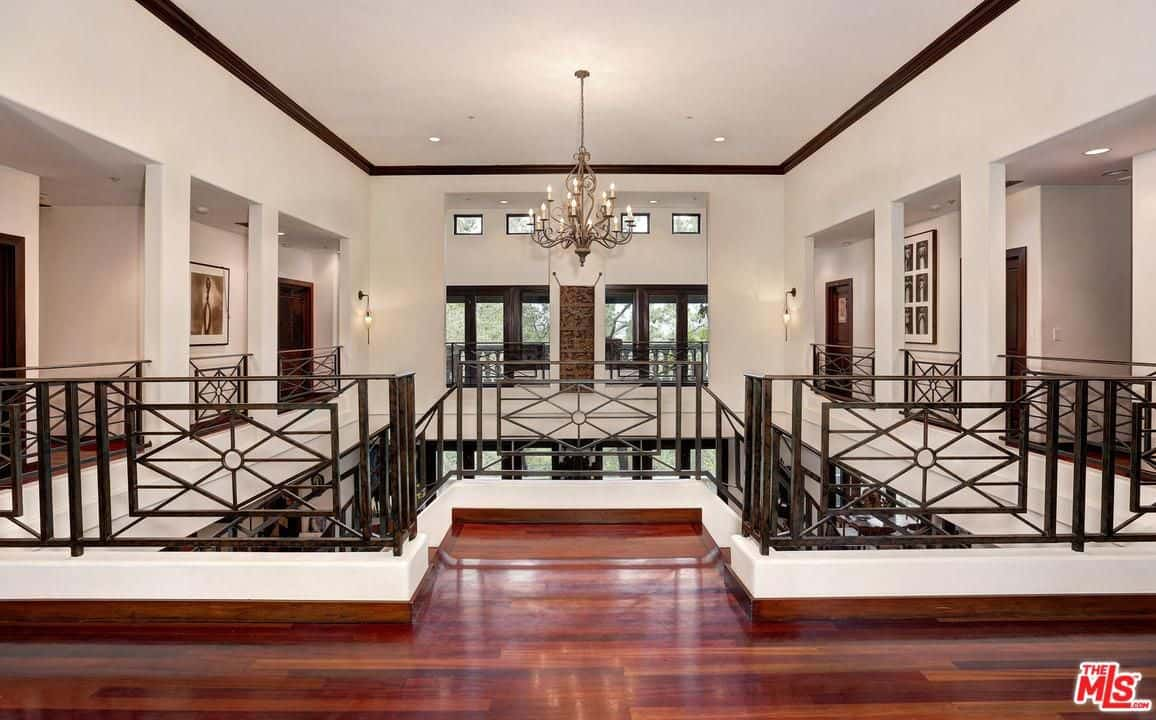 Hardwood floors, white walls and recessed lights make up the house's second floor.