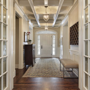 Foyer with white French doors