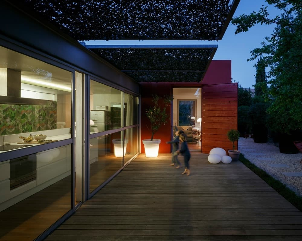 The pad's deck with black shading and hardwood flooring. Photo credit: Julien Kerdraon