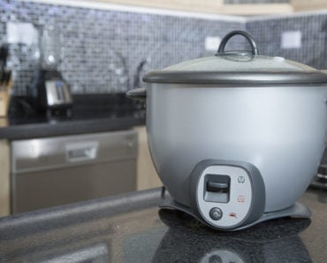 Gray rice cooker sitting on the counter