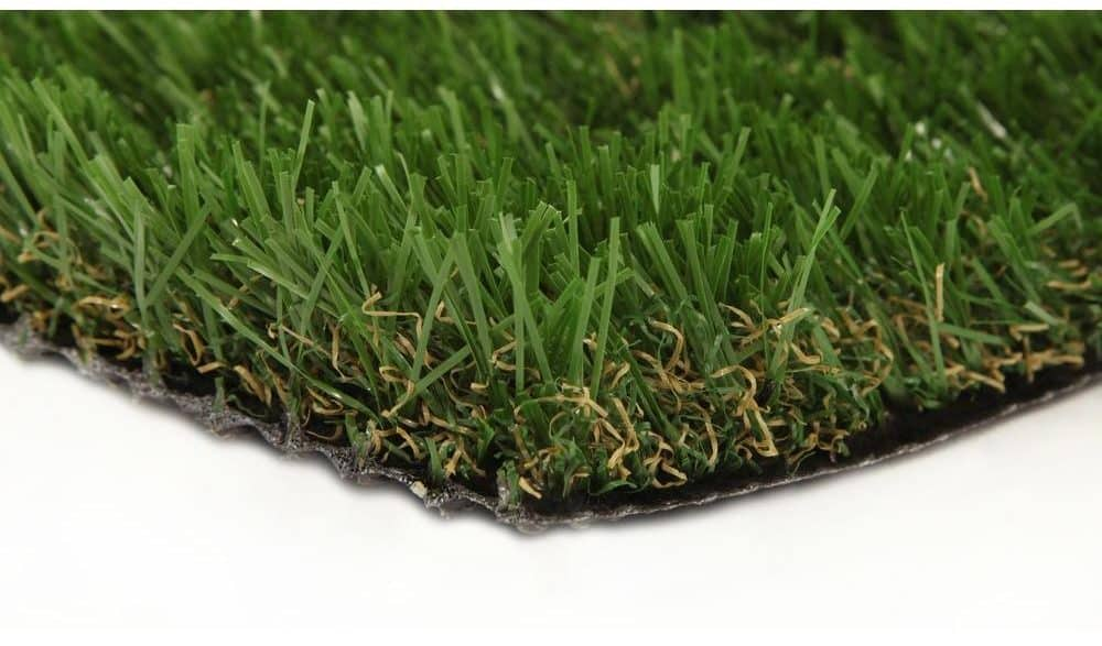 Green, synthetic grass carpet with urethane backing.