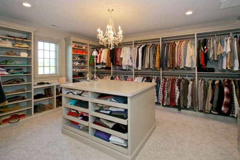 Another look of the walk-in closet showing the beautiful countertop and chandelier.