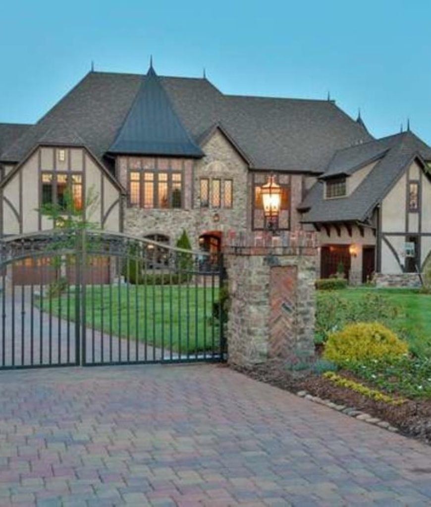 Family and friends are greeted by a beautiful traditional gated entryway of the mansion.