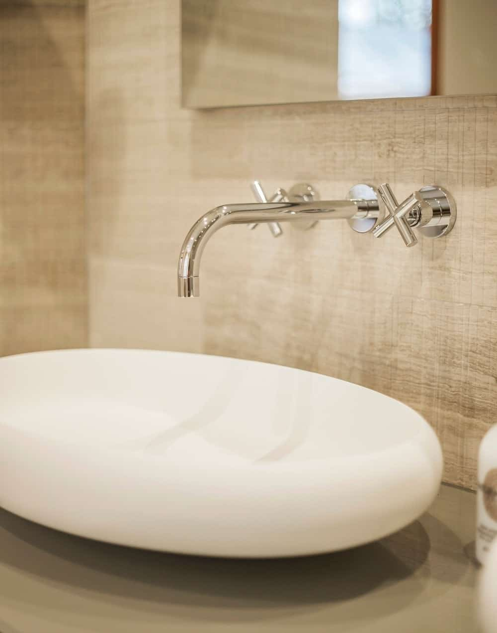 Contemporary bathroom focusing on the vessel sink. Photo credit: Photography / Styling : Rick Mccullagh / LLI Design