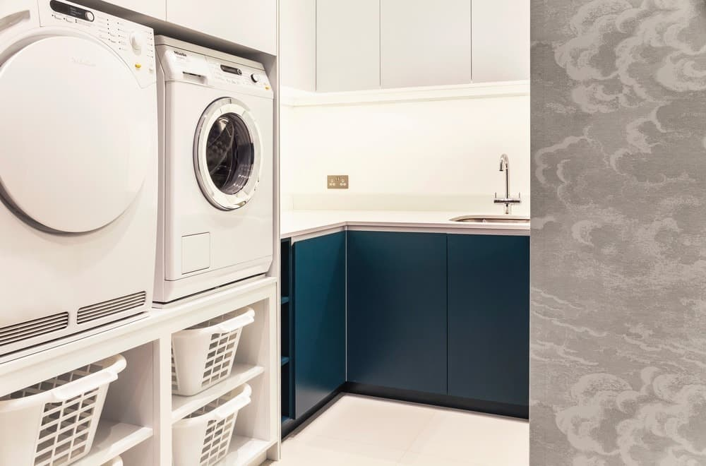 101 incredible laundry room ideas for 2018 contemporary laundry room with white walls and blue storage photo credit photography styling rick mccullagh lli designlli design solutioingenieria Gallery