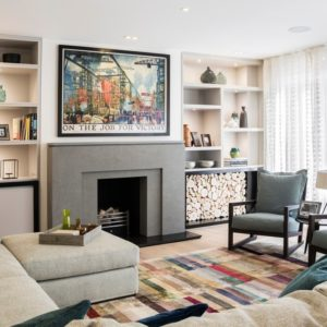 Contemporary formal living room with stylish rug and built-in shelves along with a fireplace and wall decor. Photo credit: Photography / Styling : Rick Mccullagh / LLI Design