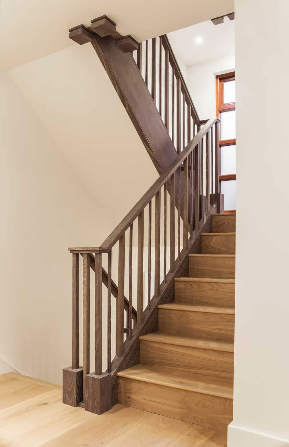 Staircase with hardwood flooring and wooden rails. Photo credit: Photography / Styling : Rick Mccullagh / LLI Design