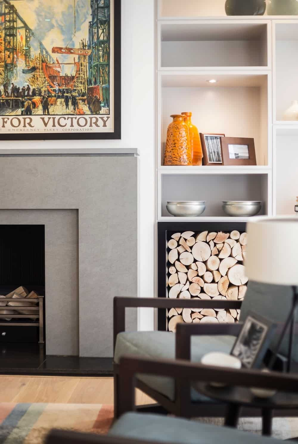 Contemporary living room with built-in shelves and fireplace along with wall decor. Photo credit: Photography / Styling : Rick Mccullagh / LLI Design