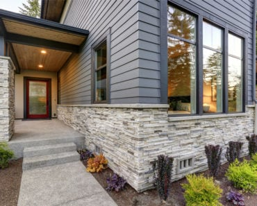 Home with natural veneer stone siding