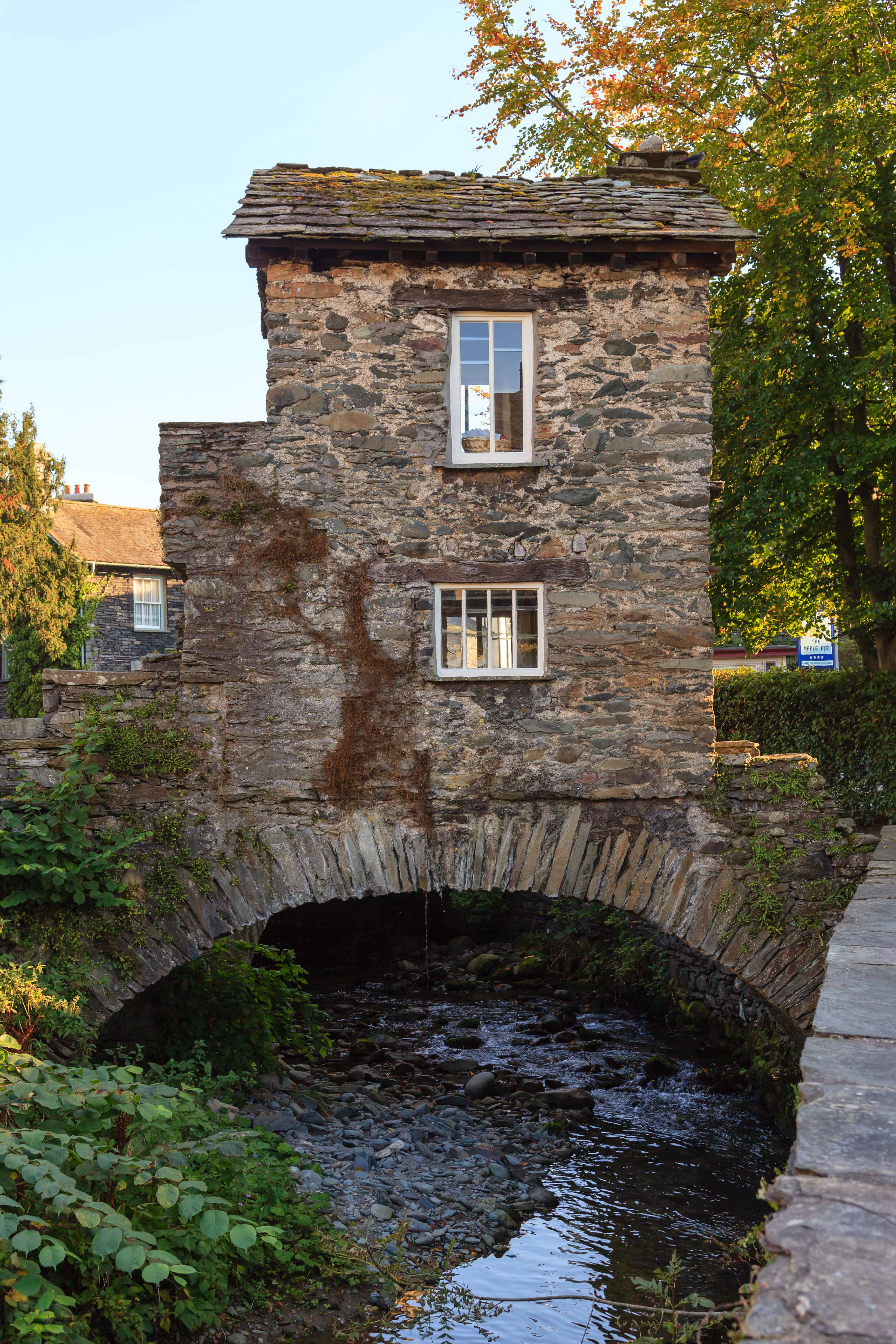 AMBLESIDE, ENGLAND - Bridge House a 17th century old stone cottage perched over Stock Beck in Ambleside, Cumbria, in the English Lake District.