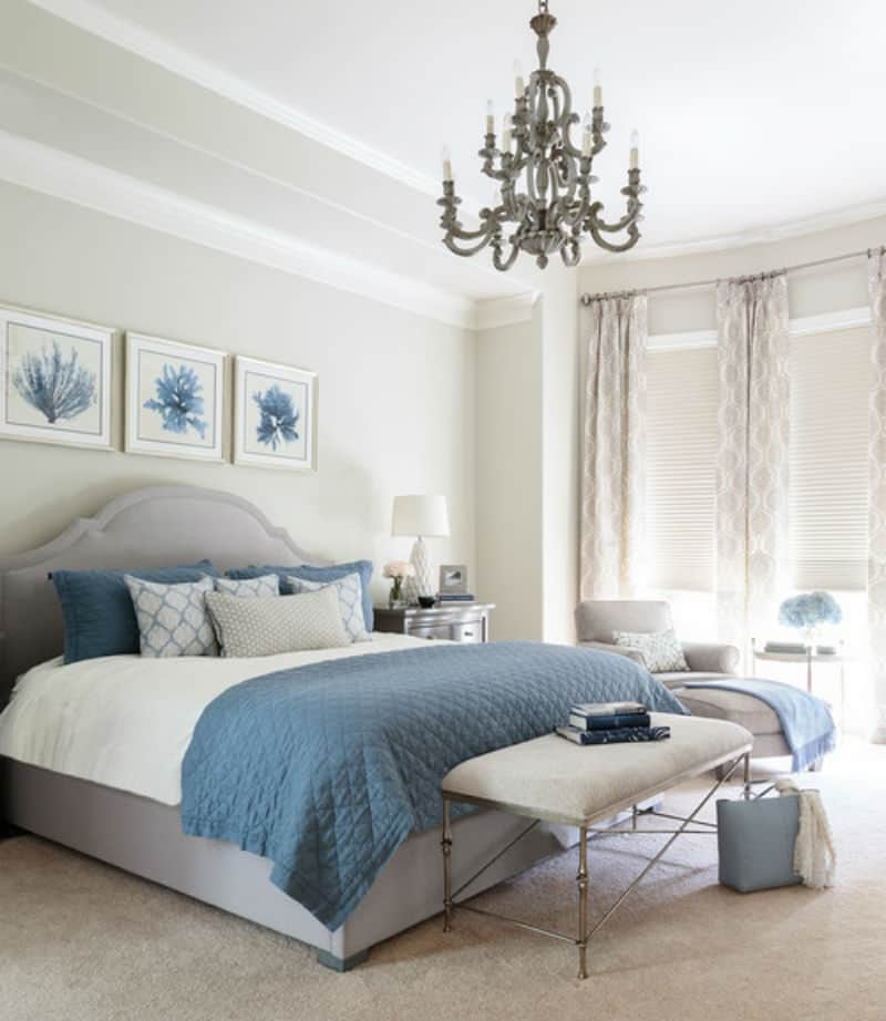 Beach-style bedroom with touches of grey and blue.
