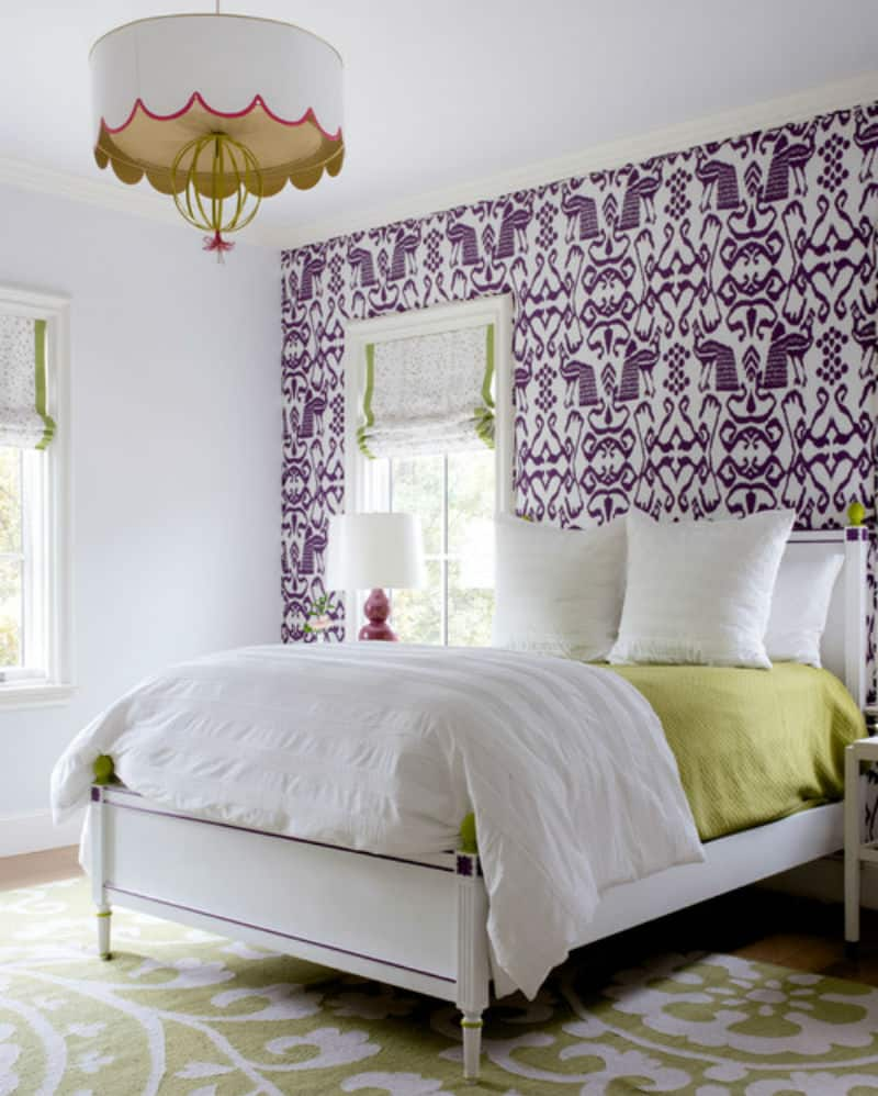 Transitional bedroom with touches of grey, violet, green, and brown.